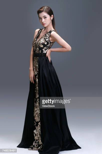 elegant woman in evening dress - evening wear stock pictures, royalty-free photos & images