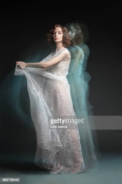 Elegant woman in waving dress