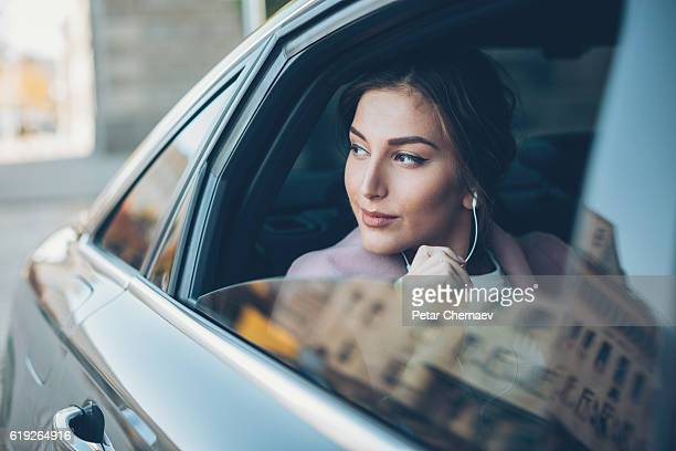 Elegant woman looking out of a car window