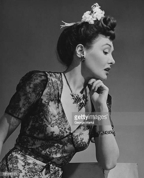 Elegant woman posing in studio (B&W),