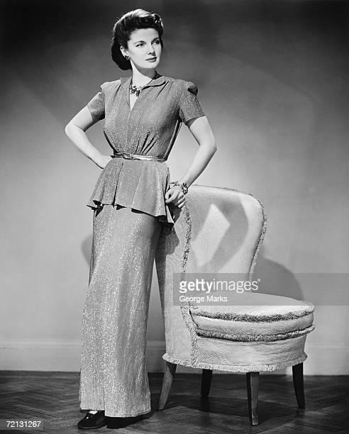 Elegant woman posing in studio (B&W), portrait