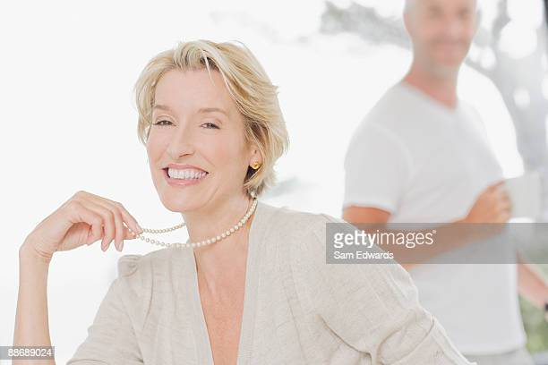 elegant woman smiling - pearl necklace stock pictures, royalty-free photos & images