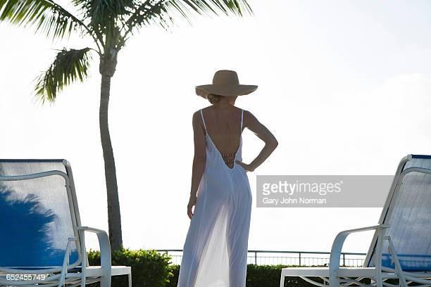 Elegant woman standing on pool deck