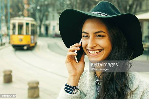 Elegant woman using smartphone on the street