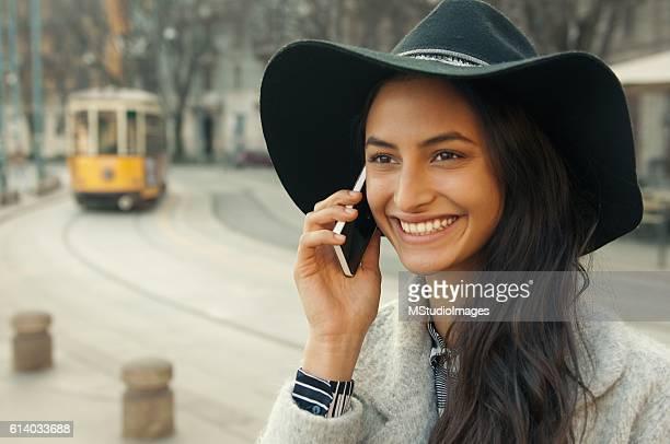 Elegant woman using smartphone on the street