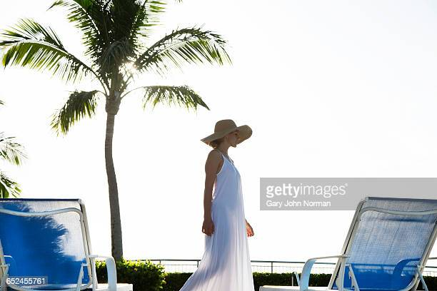 Elegant woman walking on pool deck
