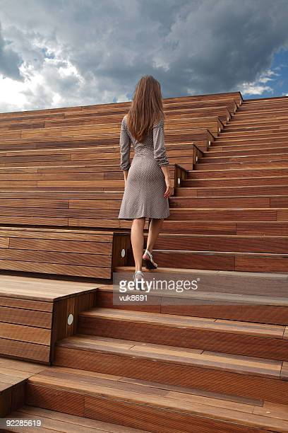 Elegant woman walking on stairs