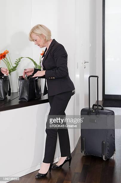 Elegant woman with baggage holding keyring