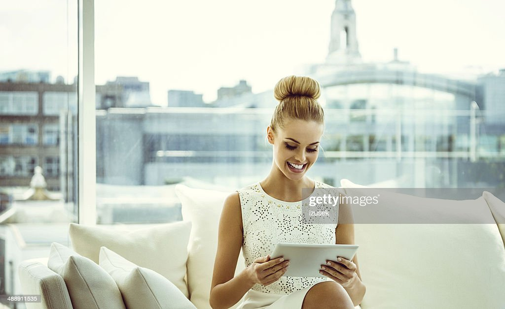 Elegant woman with digital tablet : Stock Photo