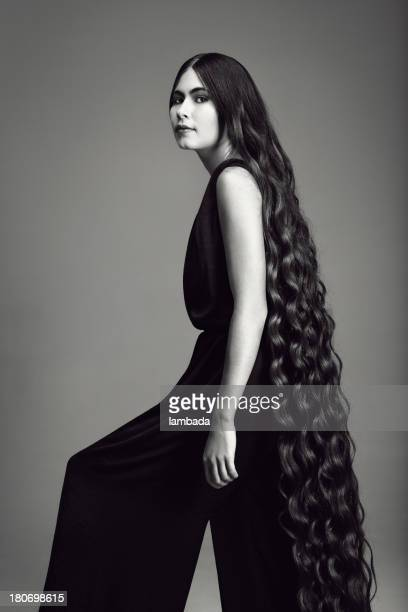 elegant woman with long hair - black jumpsuit stock pictures, royalty-free photos & images