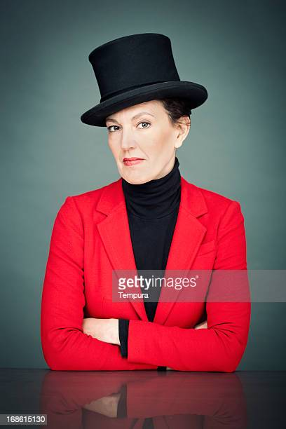 Elegant woman with top hat and red suit.