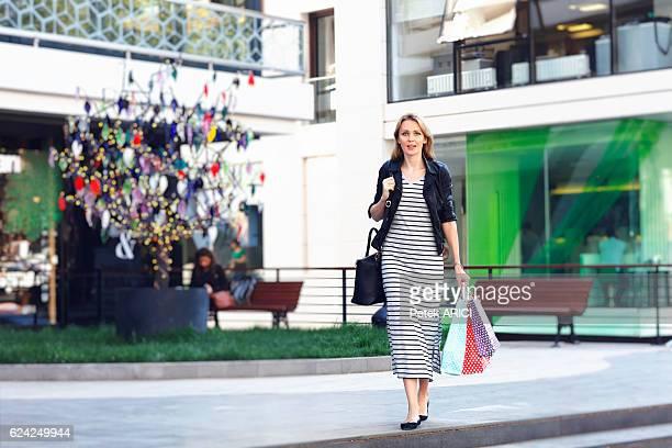 elegant women making shopping - kadikoy stock photos and pictures