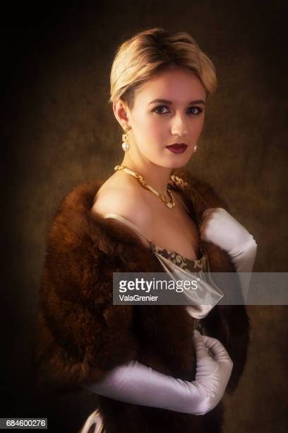 elegant young blonde woman in 1940s era outfit, waist up. - gold dress stock pictures, royalty-free photos & images