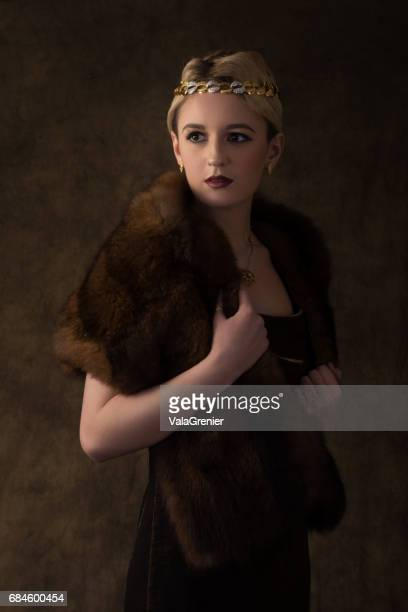 elegant young blonde woman in fur and head band, waist up. - metallic dress stock pictures, royalty-free photos & images