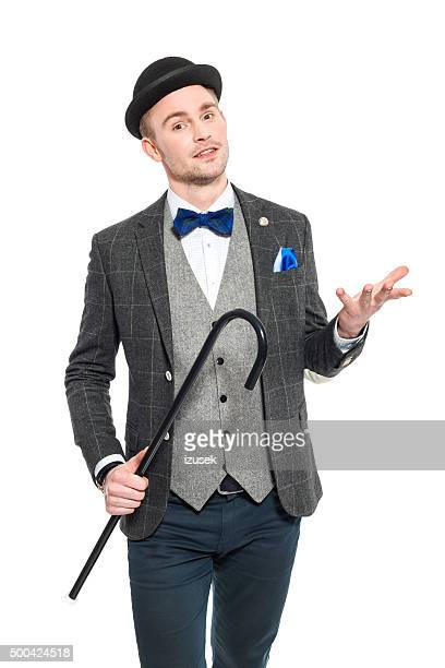Elegant young businessman in retro style outfit