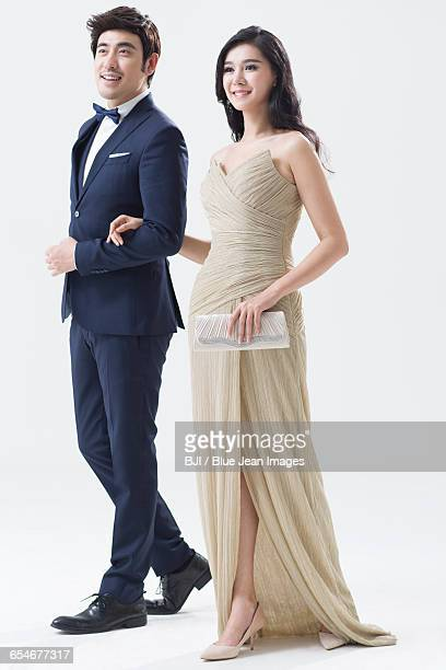 elegant young chinese couple walking - evening wear stock pictures, royalty-free photos & images