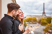 Elegant Young Couple Drinking Champagne in Paris