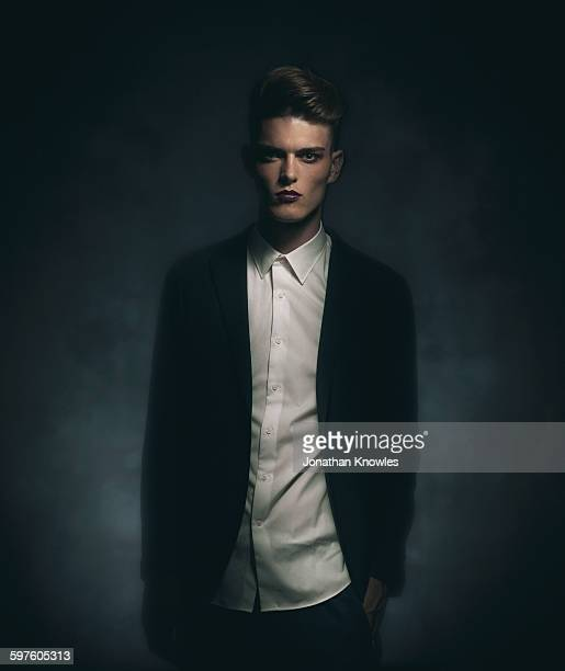 Elegant young man with make up, moody