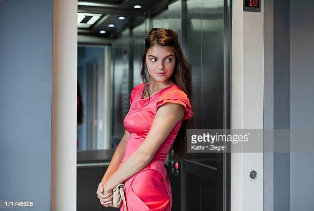 elegant young woman entering elevator