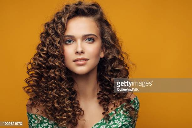elegant young woman - curly stock pictures, royalty-free photos & images