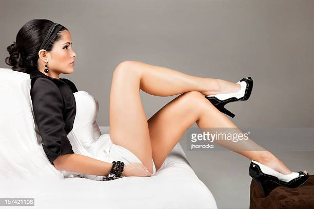 elegantly beautiful latin woman - beautiful legs in high heels stock photos and pictures