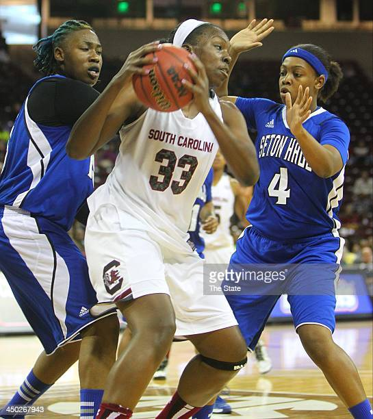 Elem Ibiam of the South Carolina Gamecocks is pressured by Brittany Webb and Jasmine McCall of the Seton Hall Pirates during the firsthalf of action...