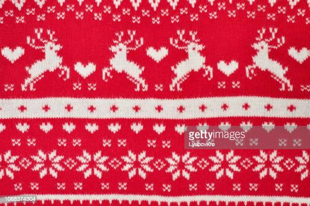 element decor christmas red knitted sweater close-up. holiday gift. backgdound - jersey de pico fotografías e imágenes de stock