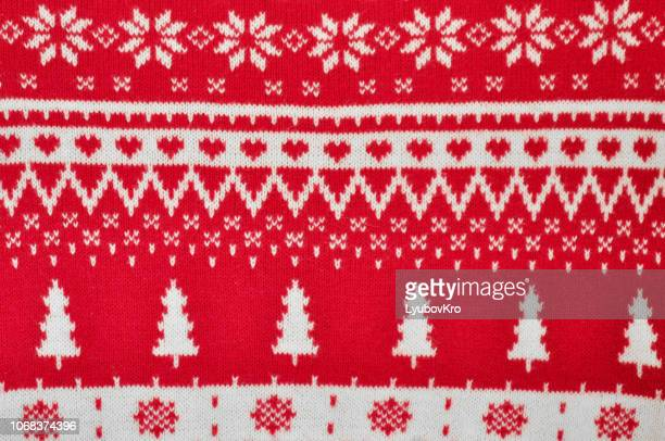 element decor christmas red knitted sweater close-up. holiday gift. backgdound - jumper stock pictures, royalty-free photos & images