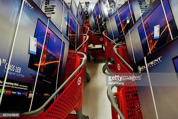 Element Electronics 50inch lightemitting diode high definition televisions sit in shopping carts before a Target Corp store opening ahead of Black...
