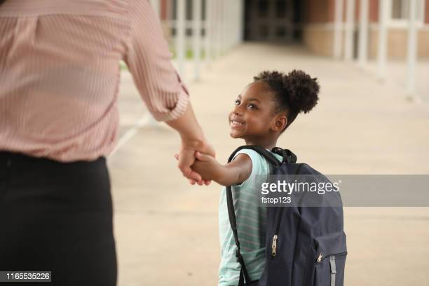 elementary, african american girl with mom on first day of school. - first day of school stock pictures, royalty-free photos & images