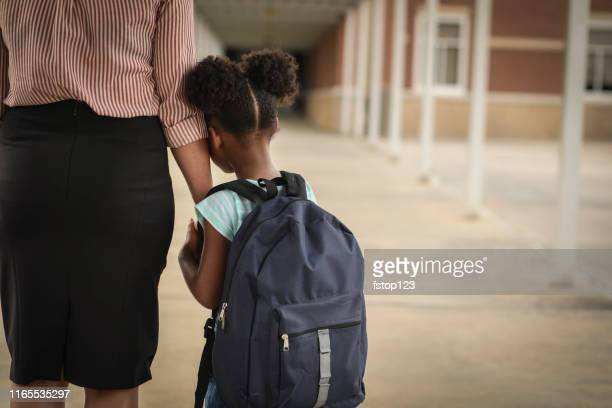 elementary, african american girl with mom on first day of school. - anxiety stock pictures, royalty-free photos & images