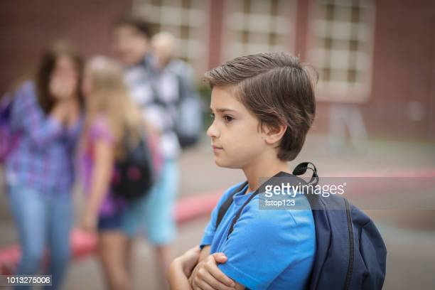 elementary age boy being bullied at school. - bullying stock pictures, royalty-free photos & images