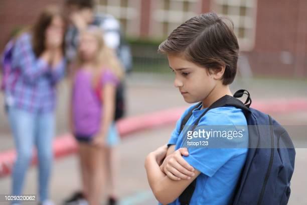 Elementary age boy being bullied at school.