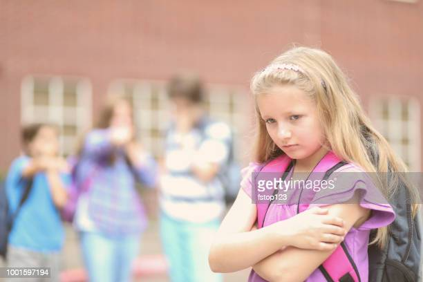 Elementary age girl being bullied at school.