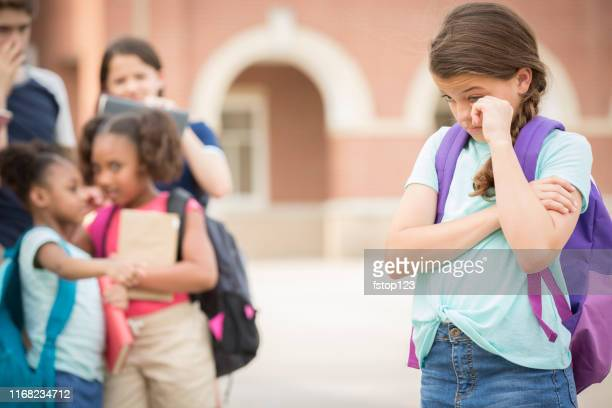 elementary age girl being bullied at school. - teasing stock pictures, royalty-free photos & images