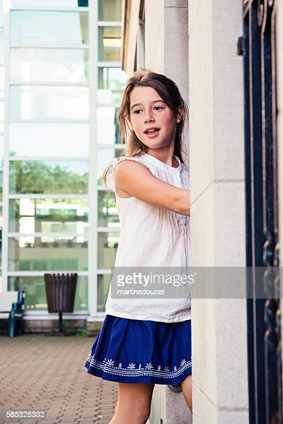 """elementary age girl near a door in school playground outdoors. - """"martine doucet"""" or martinedoucet stock pictures, royalty-free photos & images"""