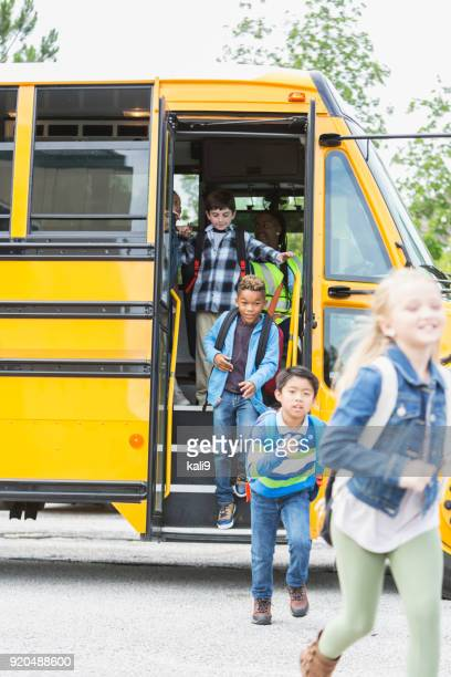 elementary children exiting school bus - disembarking stock pictures, royalty-free photos & images