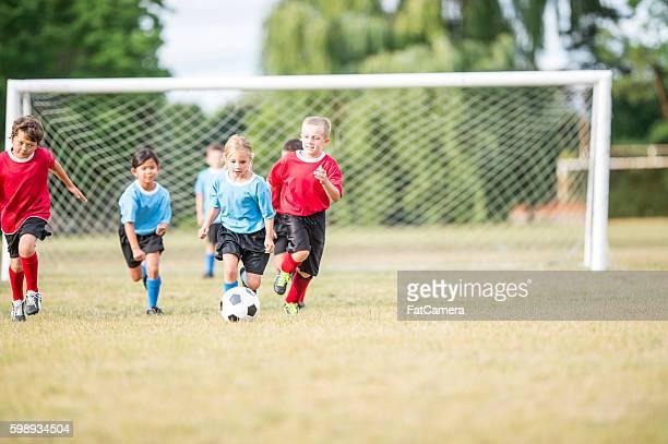 Elementary Children Playing Soccer