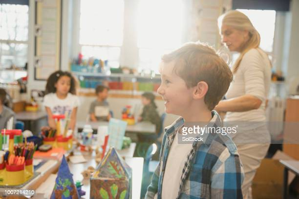 elementary class in progress - primary age child stock pictures, royalty-free photos & images
