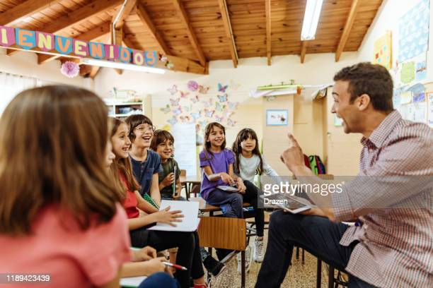 elementary education in latin america - brainstorming with teacher after the class - knowledge is power stock pictures, royalty-free photos & images