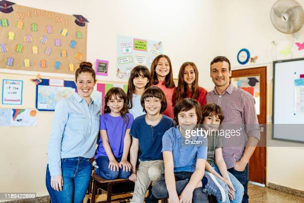 elementary education in latin america - portrait of teachers with school kids - knowledge is power stock pictures, royalty-free photos & images