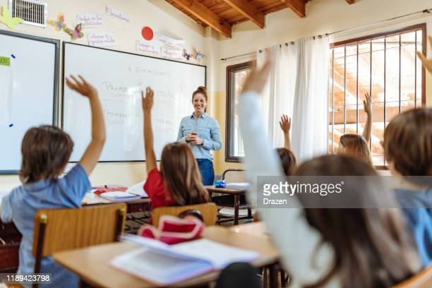 elementary education in latin america - teacher sharing knowledge with school children - knowledge is power stock pictures, royalty-free photos & images