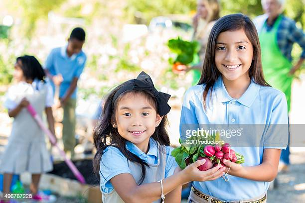 Elementary girls touring garden during farm field trip