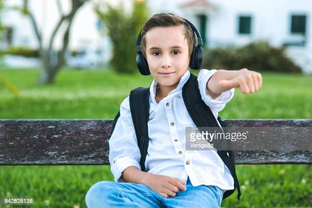 Elementary school boy listening music
