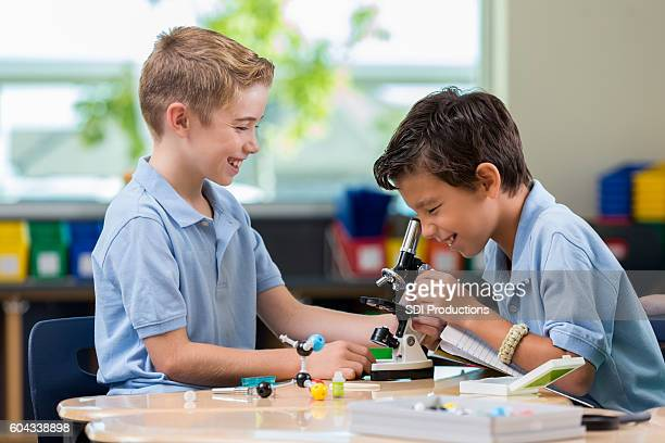 Elementary school boys work on science project