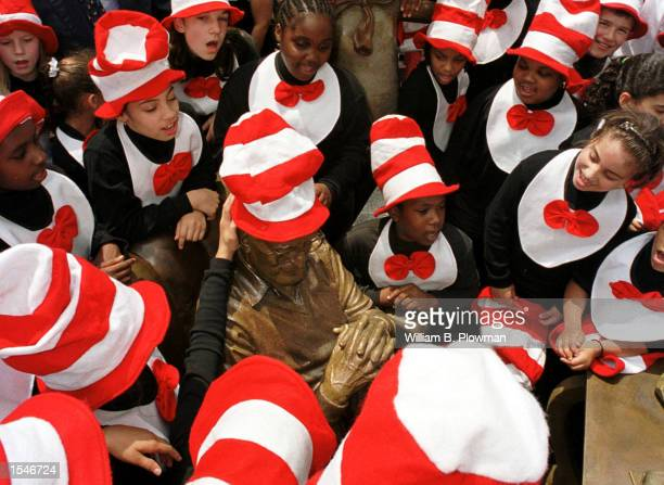 Elementary school children crowd around a sculpture of Theodore Geisel at the opening of the Dr Suess Memorial Sculpture Garden May 31 2001 in...