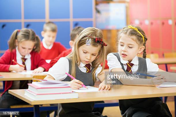 elementary school children in classroom - izusek stock pictures, royalty-free photos & images