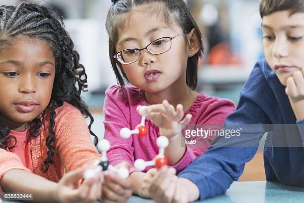 Elementary school children in science class