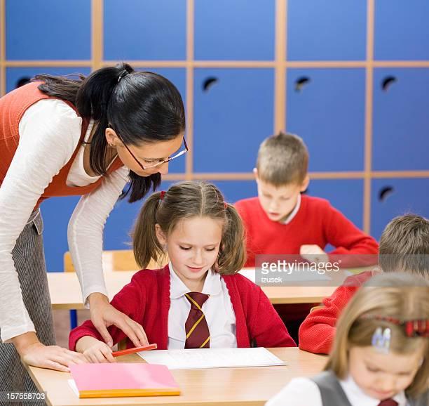 elementary school children teacher helping - izusek stock pictures, royalty-free photos & images