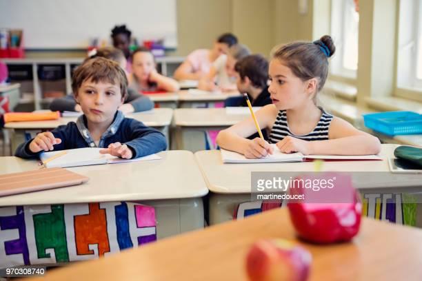 Elementary school children working in classroom.
